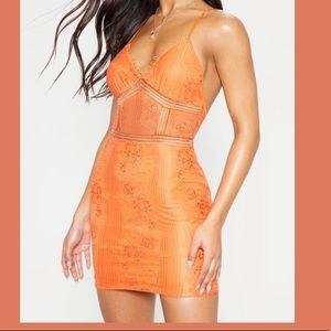 Tiny Orange Lacey dress from Pretty Little Thing